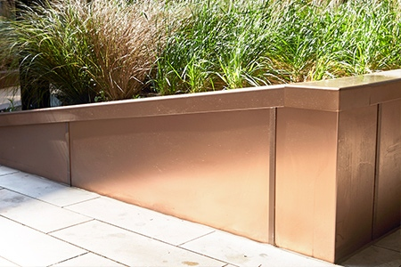 Embassy Gardens – planters in Bronze sandblasted PVD stainless steel