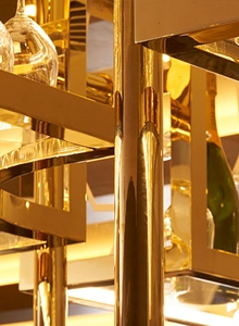 Detail of overhead bar rack in the Devonshire Club Hotel Brasserie created from V- Grooved PVD in Champagne Mirror.