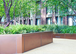Embassy Gardens - planters in Bronze sandblasted PVD stainless steel Case Study