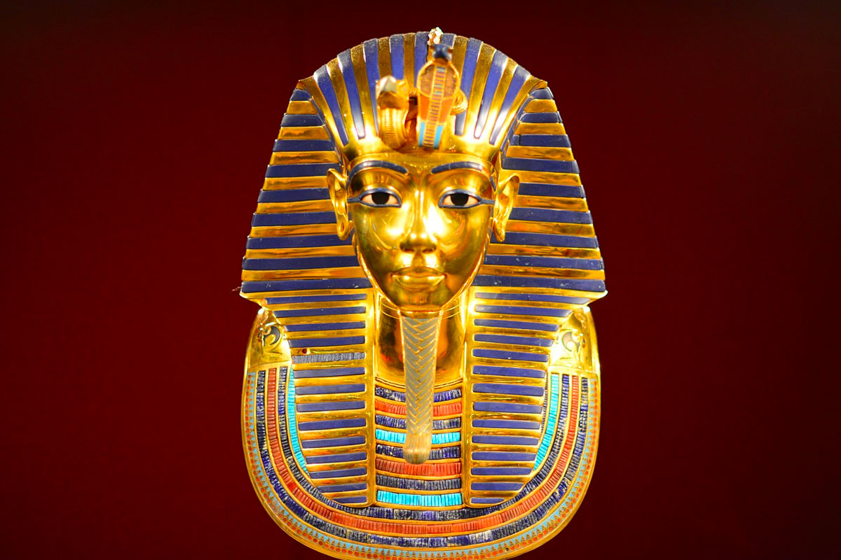 The death mask of Egyptian Pharaoh Tutankhamun. The mask was discovered in 1922 by British archeologist Howard Carter, and is predominantly made from gold with cobalt blue glass.